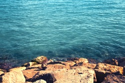 Sea landscape background, water and rock, empty copy space