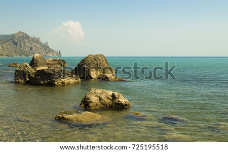 Nudist beach in the summer at Koktebel in Crimea in the