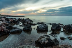 Sea landscape. Evening on the stone beach.
