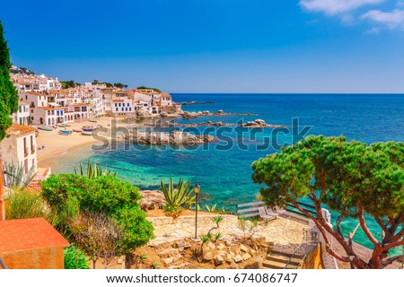 Sea landscape with Calella de Palafrugell, Catalonia, Spain near of Barcelona. Scenic fisherman village with nice sand beach and clear blue water in nice bay. Famous tourist destination in Costa Brava #674086747