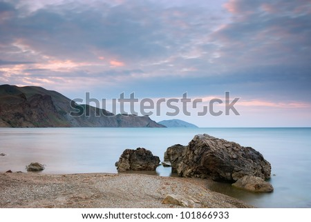 Sea landscape with cape and the cloudy sky. Crimea, Ukraine.