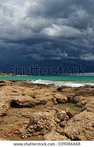 Sea landscape with coast view. Storm sky with lightning,