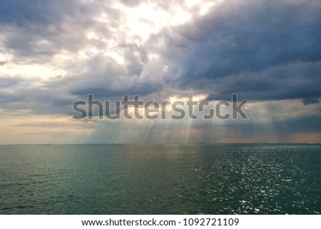 Sea landscape with rainy weather and cloudy skies
