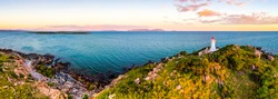 Sea lighthouse on the top of the hill panorama. Lighthouse hill. Lighthouse sea panorama. Lighthouse panoramic landscape