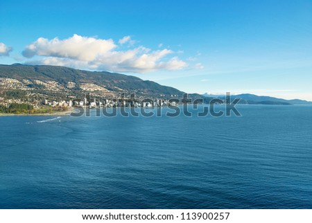 Sea near Vancouver Canada with city on the other bank