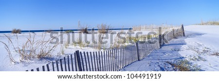 Sea oats and fence along white sand beach at Santa Rosa Island near Pensacola, Florida