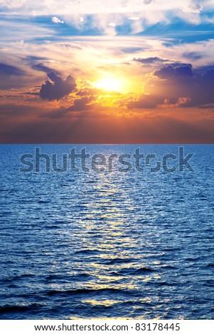 Sea, ocean at colorful sunset, vertical