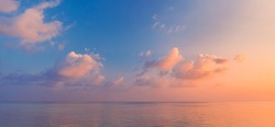Sea ocean horizon. Skyscape with seascape. Orange and golden sunset sky, soft sand, calmness, tranquil relaxing sunlight, summer mood. Inspirational nature view, wide horizon of the sky and the sea
