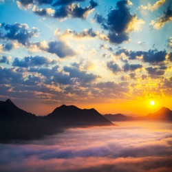 Sea of clouds on sunrise with ray lighting