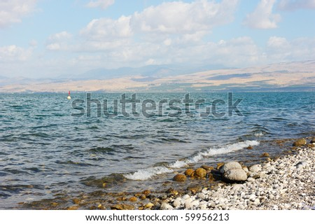 Sea of Galilee in the early morning, ripples on the water and clouds in the sky