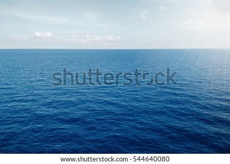 sea on blue sky sunlight background