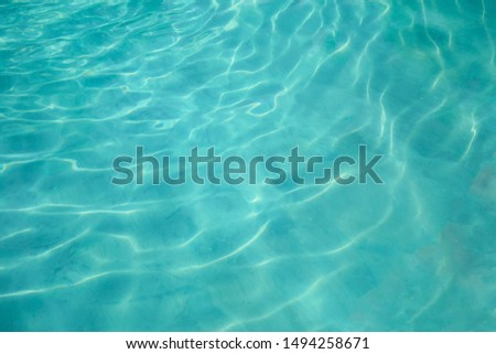 Sea or ocean surface. Still cyan water with small wimples. Concept of calmness and purity
