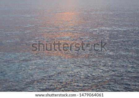 Sea or ocean water surface with sun reflection background. #1479064061