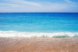 Sea pebble beach against the sky. Beach and sea. Seascape