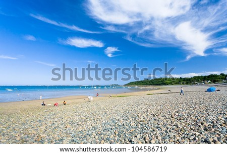sea pebble beach in Brittany, France in summer day