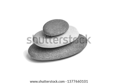 Sea pebble. Group of smooth grey and black stones. Pebbles isolated on white background