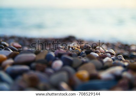 Sea pebbles background. Macro shot. Copy space #708529144