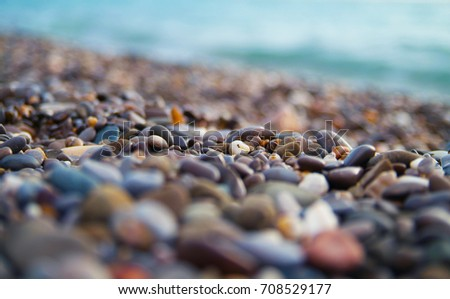 Sea pebbles background. Macro shot. Copy space #708529177