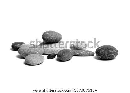 Sea pebbles. Heap of scattered and stacked smooth gray and black stones isolated on white background