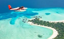 Sea plane flying above Maldives islands