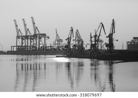 Sea port with cranes and docks early in the morning