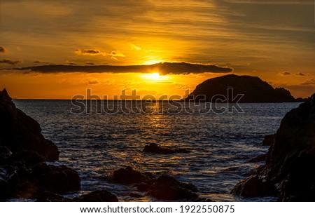 Sea rock sunset water horizon. Sea sunset horizon landscape. Sea sunset landscape. Sunset sea horizon landscape