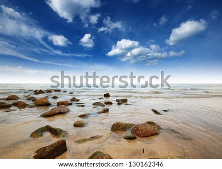 sea rock wave nature sand sun landscape blue sky sunlight for wallpaper and design