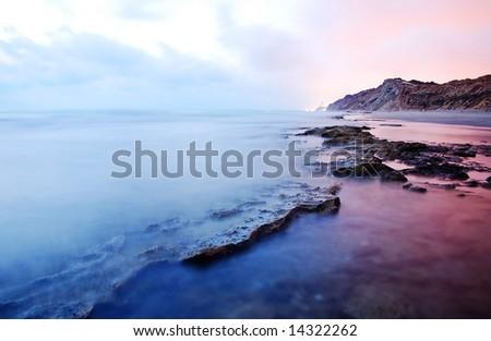 sea rocks long exposure sunset