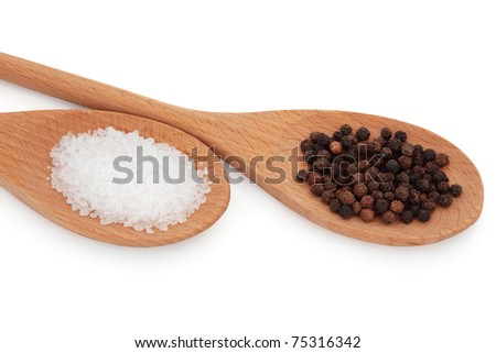 Sea salt and black peppercorns in two wooden spoons, over white background.