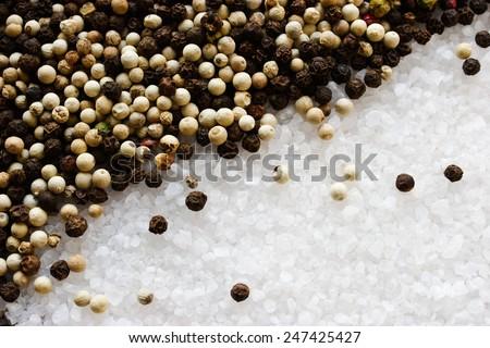 Sea salt, black and white pepper background