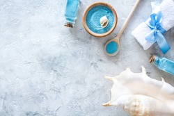 Sea salt from dead sea and shell in cosmetics set for spa on gray background top view copyspace