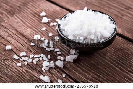 sea salt in bowl on wooden background