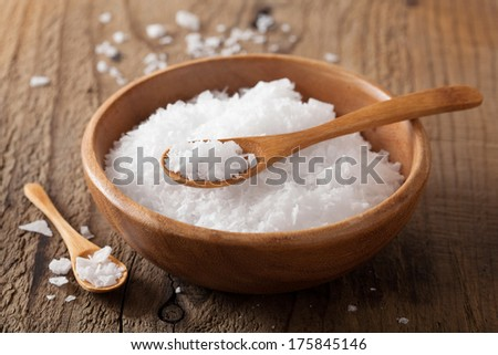 sea salt in wooden bowl and spoon