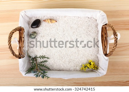 sea salt on the spacing with the elements of nature and note-book on wooden background
