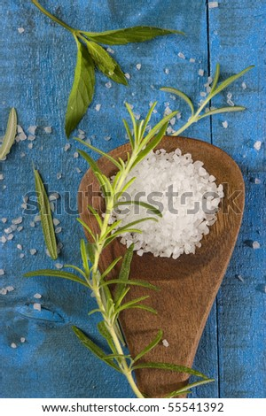 sea salt with herbs in a wooden spoon
