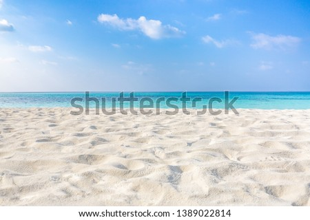 Sea sand sky concept. Closeup of sand on beach and blue summer sky, calmness and inspiration nature concept