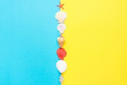 Sea Shells of Different Shapes Spiral Flat Red Starfish on Split Duo Tone Yellow Blue Background Imitating Ocean Sand. Summer Sale Vacation Beach Party Spa Wellness Concept. Poster Streamer Banner