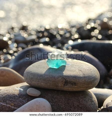 Sea shore and sea glass.  #695072089