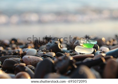 Sea shore and sea glass.  #695072095