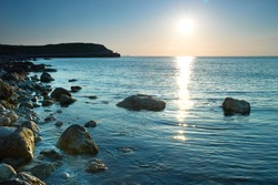 Sea shore and stones. Seascape at sunset.