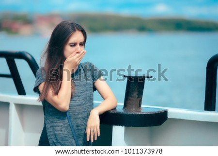 Sea sick woman suffering motion sickness while on boat. Suffering girl traveling on water and feeling fearful and unwell  #1011373978