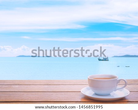 Sea, sky and white clouds.wave Nature overlooking the fishing boats. With coffee cup. the holidays., in Thailand. Feelings, sadness, loneliness, nostalgia. #1456851995