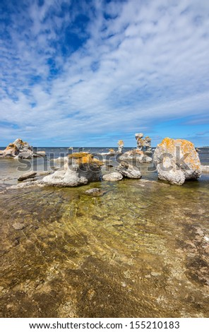 Sea stacks (raukar) on Faro island in Gotland, Sweden. These limestone formations are caused by natural erosion.