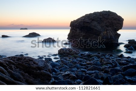 Sea stones during sunrise