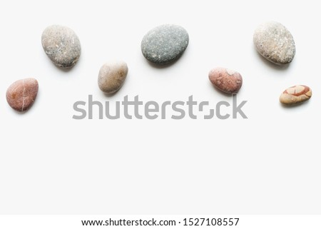 sea stones on a white background, white background with stones