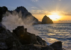 sea stormy rock cost in sunrise morning