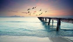 sea sunset on the wooden pier. Spain, Majorca.