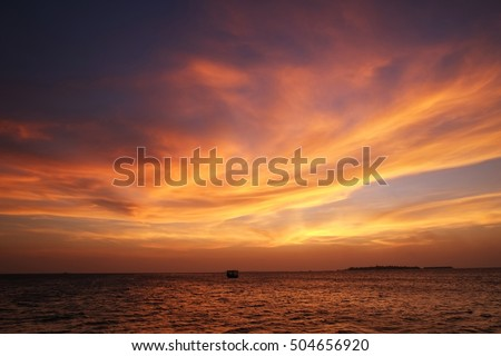 Shutterstock sea sunset with dramatic clouds at Maldives