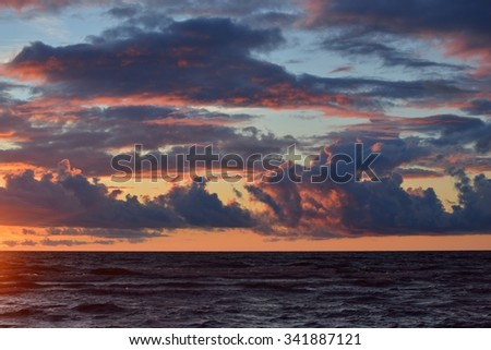 Sea sunset with dramatic stormy clouds #341887121