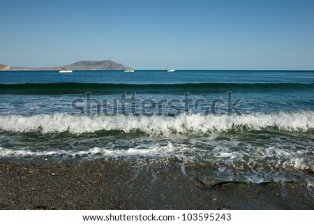 sea surf with far mountains at background